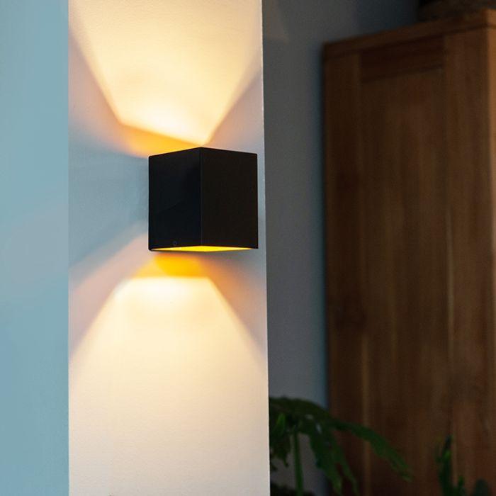 Moderne-wandlamp-zwart/goud---Sola